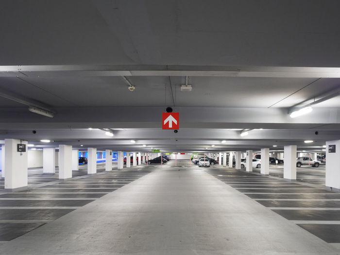 Interior of illuminated underground parking lot