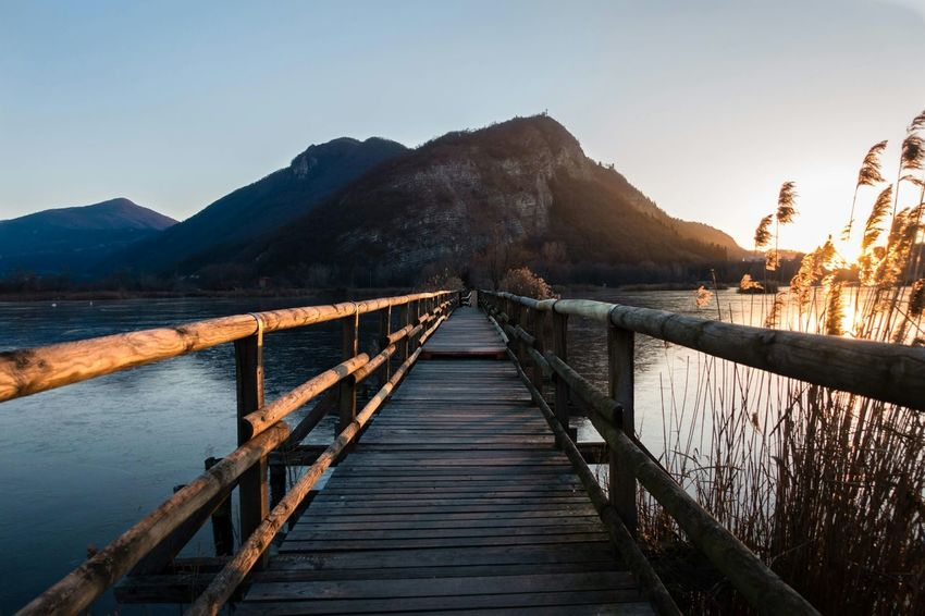 Landscape Bridge - Man Made Structure Lake Mountain Beauty In Nature Vacations Outdoors Nature Water No People Day Sunrise Scenics Iseo Torbieredelsebino Sky Wheelchair Access First Eyeem Photo