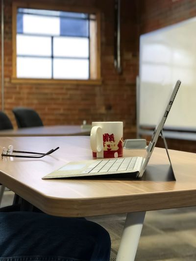 Brick Interior Walls Super Thin Laptop Coffee Cup Window Reading Glasses Natural Light Indoor Photo Startup Indoors  Desk Table Wireless Technology Technology Modern Workplace Culture Laptop Working No People Computer EyeEmNewHere