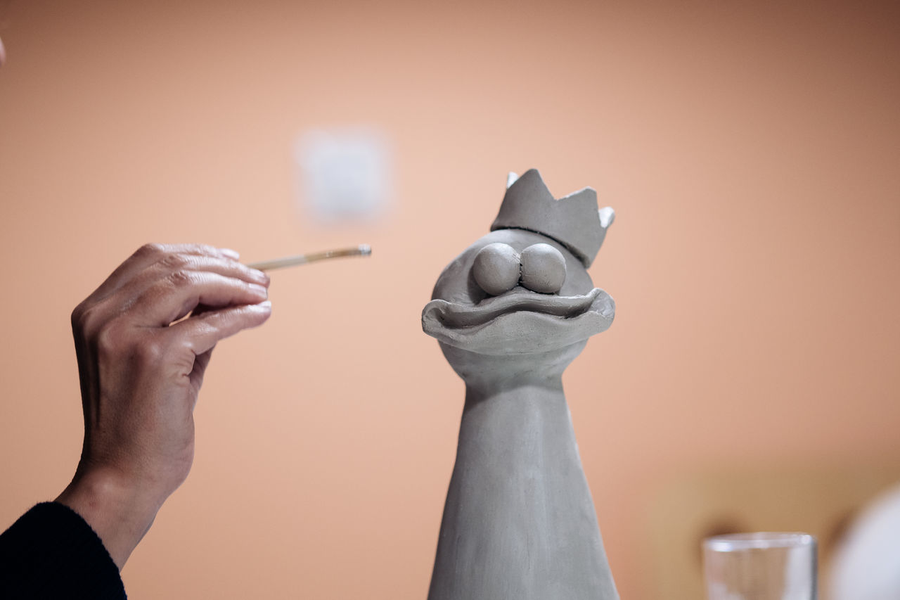 Cropped Image Of Hand Working On Ceramic Sculpture At Workshop