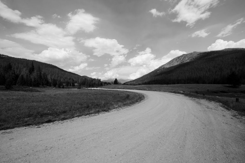 EyeEmNewHere Colorado Colorado Photography Beauty In Nature Cloud - Sky Day Direction Empty Road Environment Field Land Landscape Long Mountain Nature No People Non-urban Scene Road Scenics - Nature Sky The Way Forward Tranquil Scene Tranquility Transportation