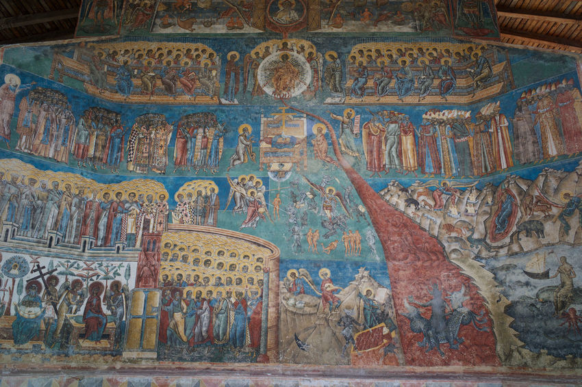 Beautiful religious fresco at Voronet Monastery in Suceava, Romania. Ancient Christian Graffiti Travel Ancient Civilization Architecture Art And Craft Belief Blue Building Built Structure Ceiling Drawing Fresco Heritage History Mural No People Place Of Worship Religion Spirituality Suceava The Past Travel Destinations Voronet