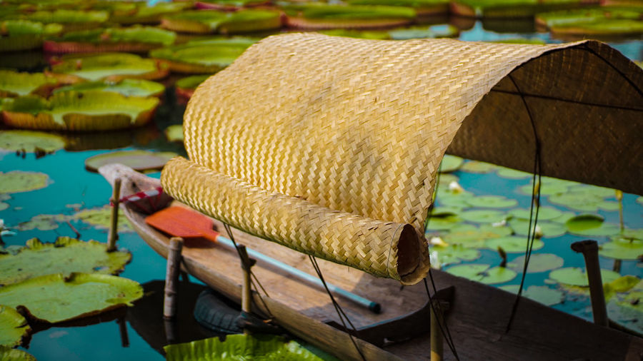 Close-up of hat on boat moored in lake
