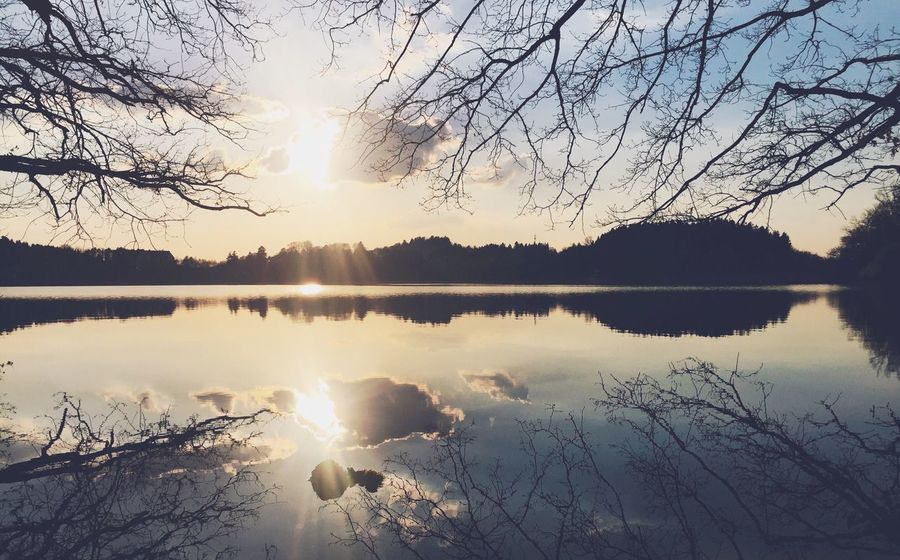 •light• Reflection Sun Nature Beauty In Nature Sunset Water Sky Tranquil Scene Idyllic Sunlight Scenics Tree Tranquility Lake No People Silhouette Outdoors Sunbeam Sunrise Day Exceptional Photographs Tadaa Community