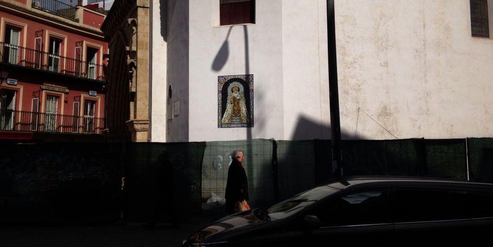 Man standing on car window