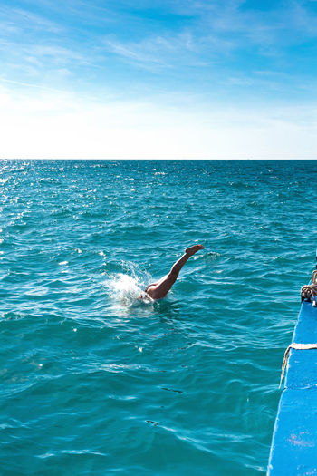Copy Space Dive In Woman Beauty In Nature Blue Day Horizon Horizon Over Water Human Arm Jumping Legs Leisure Activity Lifestyles Nature Outdoors People Real People Scenics - Nature Sea Sky Sunlight Swimming Water Water Splashes Waterfront