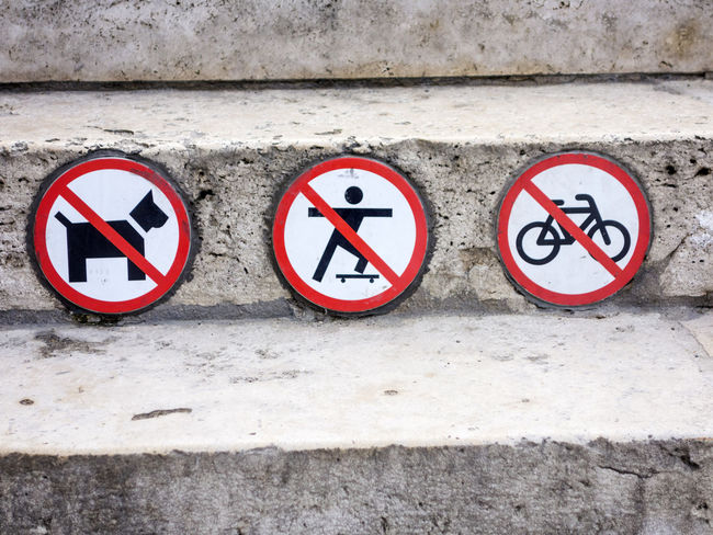 Prohibition signs Authority Public Space Architecture Built Structure Circle Close-up Communication Day Guidance No Cycling No Dogs No People No Skateboarding Outdoors Prohibited Prohibition Prohibition Sign Red Regulations Road Sign Signboard Wall - Building Feature