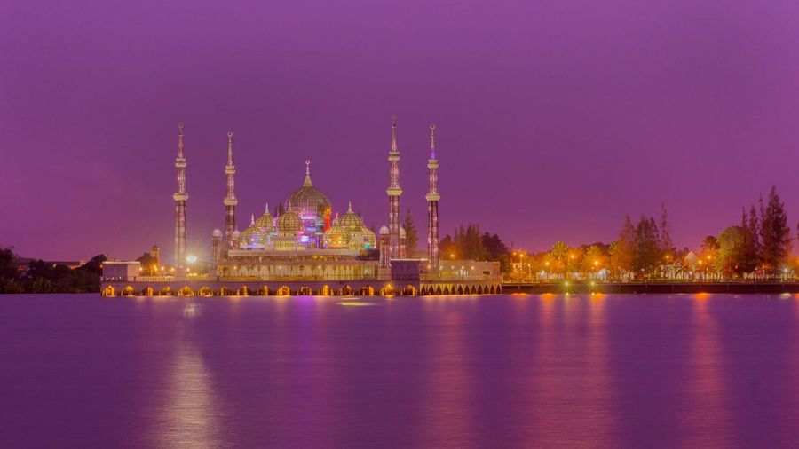 River with mosque against clear sky