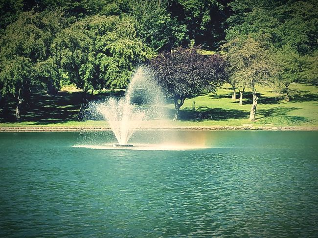 Rainbows on water is one of the most beautiful things I've seen. Water Outdoors Power In Nature Beauty In Nature Motion Fountain Water Rainbow Park Fountain