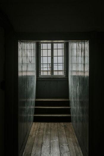 Window Indoors  No People Architecture Flooring Door Dark Wood Hardwood Floor vanishing point Centered Copy Space Design View Ocean Corridor