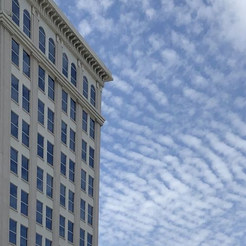 Low angle view of residential building against cloudy sky