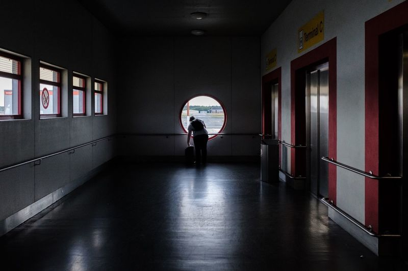 Tegel Street Hunters Streethunters Street Photography Streetphotography X100f Fujifilm X100f Arcade Corridor People Full Length Prison Building Built Structure Real People Window Women Silhouette The Street Photographer - 2018 EyeEm Awards