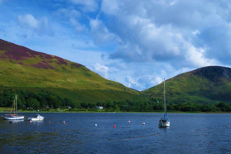 Boats sailing in lake
