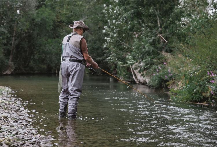 Full length of man fishing in river