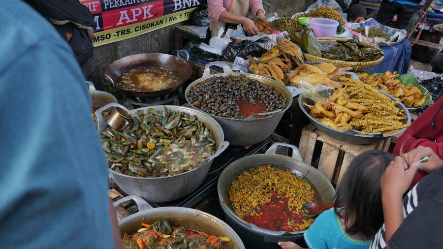 High angle view of traditional food for sale at market stall