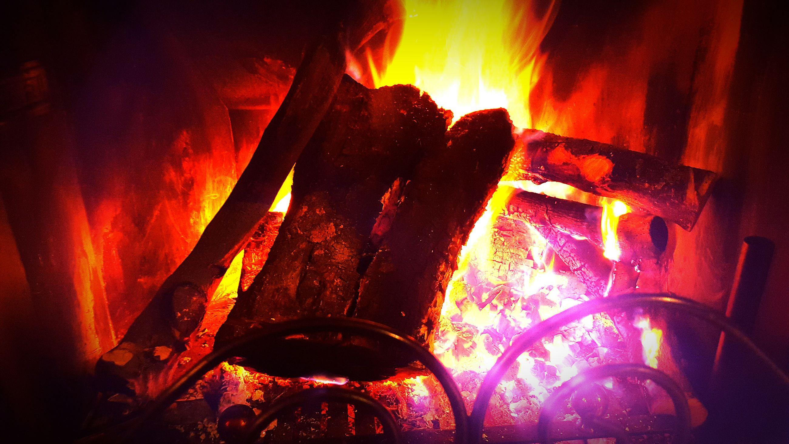 illuminated, fire - natural phenomenon, burning, indoors, flame, night, glowing, heat - temperature, light - natural phenomenon, lighting equipment, close-up, red, lit, candle, orange color, dark, spirituality, religion, fire