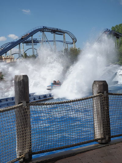 Water splashing on railing of bridge