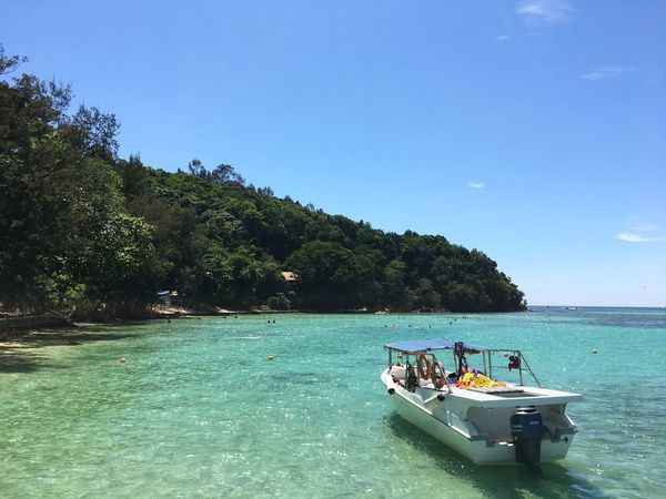 Sapi Island , Sabah Sabah Tourism Sapi Island Sabah Island Jetty Boat Water Nautical Vessel Transportation Group Of People Sky Sea Mode Of Transportation Tree Plant Nature Beauty In Nature Crowd Waterfront Scenics - Nature Blue Day Travel