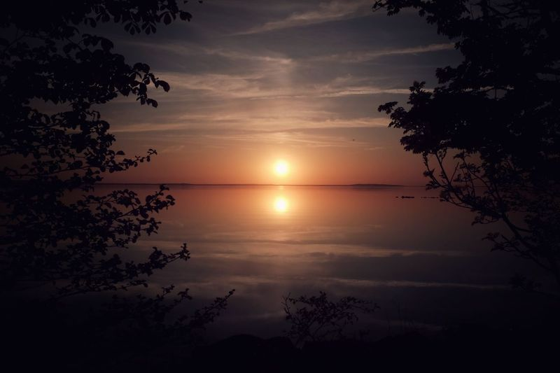 Double sun over Vättern Tranquility Tranquil Scene Peace Summer Lifestyles Summet Sweden Omberg Sky Water Scenics - Nature Beauty In Nature Sunset Tranquility Tranquil Scene Tree Orange Color Reflection Silhouette Horizon Over Water No People