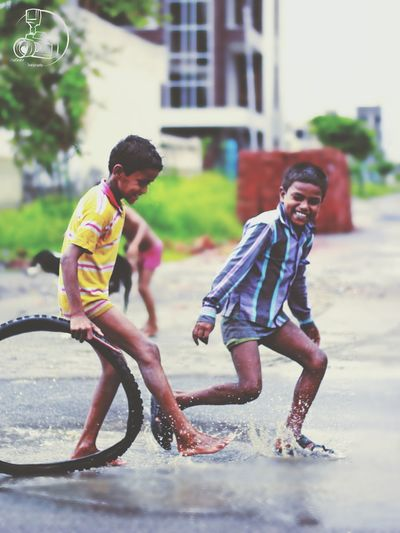 Capturing Freedom Indianstreet Childhood Rainy Days Fun Nature Ishan_Photography Photography Canon
