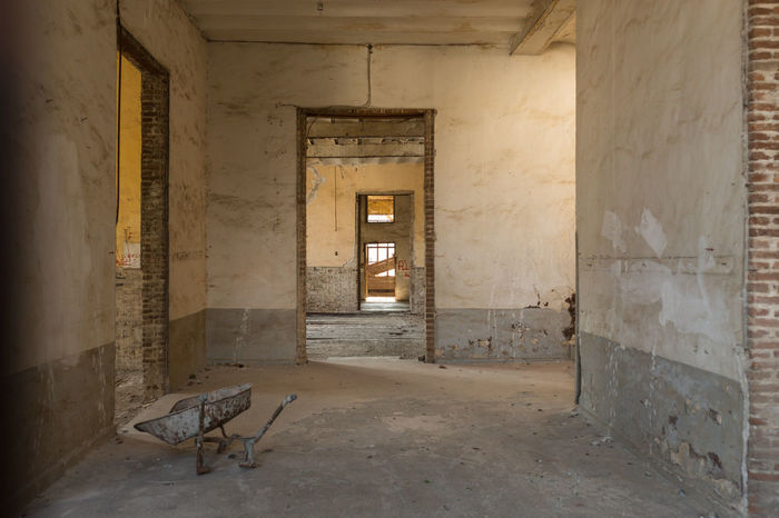 interior of a deserted building Abandoned Architecture Building Built Structure Cart Day Deserted Empty Indoors  No People School Sparse Tirilye Wheelbarrow