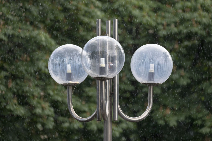 Summer rain in a public park ... street lamp with three glass spheres against trees Green Color Public Park Rain RainDrop Sphere Circle Close-up Day Design Electric Lamp Focus On Foreground Geometric Shape Glass - Material Lighting Equipment Metal Nature Outdoors Plant Selective Focus Silver Colored Street Light Three Objects Transparent Tree Wet