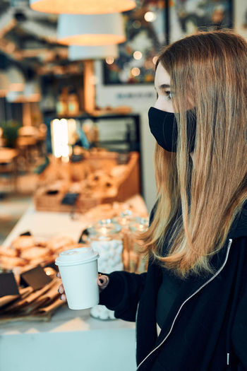 Woman with coffee cup in cafe