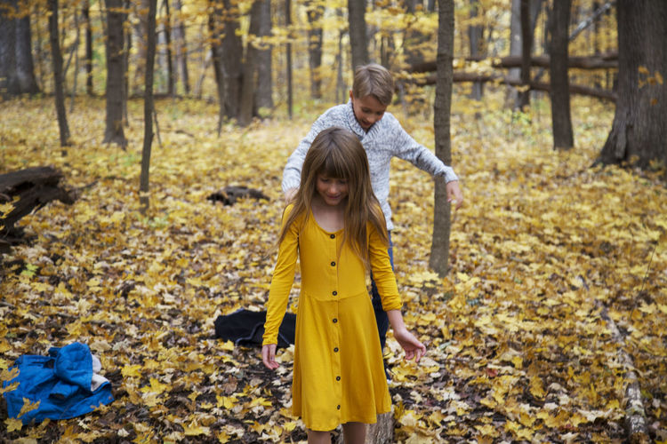 Full length of girl standing on field during autumn