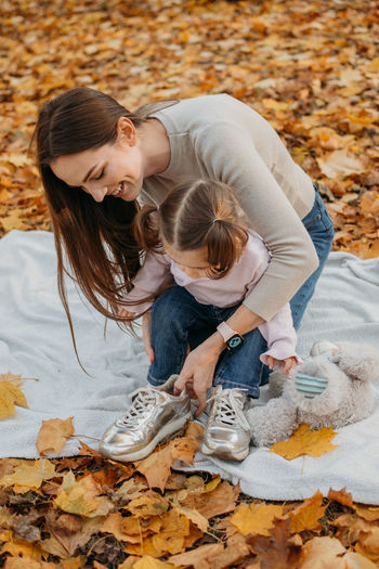 Dressing child for autumn fall outdoor play. autumn fashion for baby toddler, kids. autumn outdoor