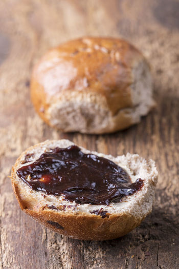 Raisin Baked Bread Breakfast Bun Close-up Dried Fruit Focus On Foreground Food Food And Drink French Food Freshness Fruit Healthy Eating Indoors  Indulgence Jam No People Ready-to-eat Rustic Still Life Studio Shot Sweet Food Wellbeing Wood - Material