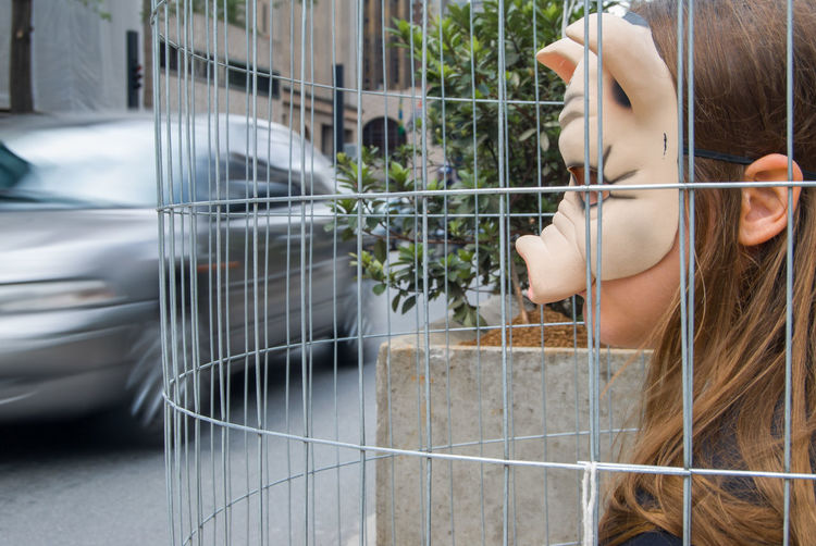 Animal rights manifestation Animal Rights Protest Adult Beautiful Woman Cage Day Females Hair Hairstyle Headshot Lifestyles Looking Manifestation Mask One Person Outdoors Pig Portrait Real People Side View Vegan Women Young Adult Young Women Be Brave