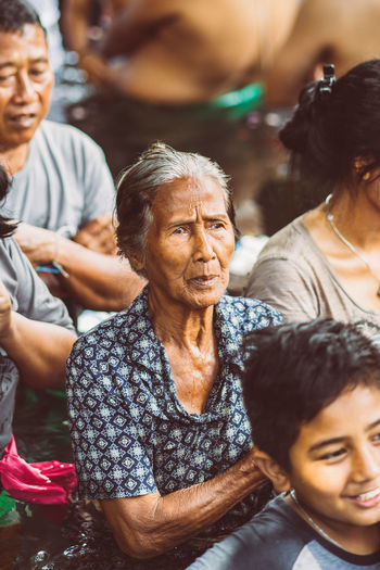 Bali INDONESIA Bali Temple Temple Water Temple Religious Festival Hindu Hinduism Real People Lifestyles Men Group Of People Males  Women Child Senior Adult Females Adult Leisure Activity Togetherness People Family Childhood Emotion Bonding Smiling Casual Clothing Happiness Positive Emotion Daughter Grandchild