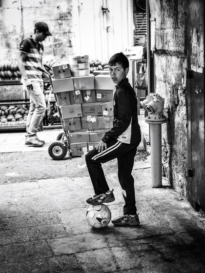 it's in the game! Boy Football Street Football Fifa Live Not Many Chances Poor Kid Streetphotography_bw Street Photography Streetphoto IN THE STREETS In The Street Streetphotography Streetphoto_bw Street Life It's Real Black And White Black & White Black&white Black And White Photography Blackandwhite Monochrome Blackandwhite Photography OneFrame OneFrame Photography