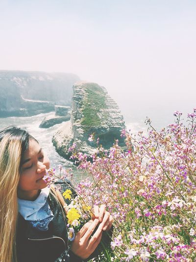 The smell of summer Flower Leisure Activity Young Women One Person Nature Outdoors Beauty In Nature Womens Portraiture Tranquil Scene Feminine  Peace And Quiet Bay Area Landscape_photography Summer Vibes Adventure Beauty In Nature EyeEm Selects Wildflowers Outdoor Photography Summer Views Smelling The Flowers Scented Coastline California Love California Dreaming Sommergefühle EyeEm Selects EyeEmNewHere