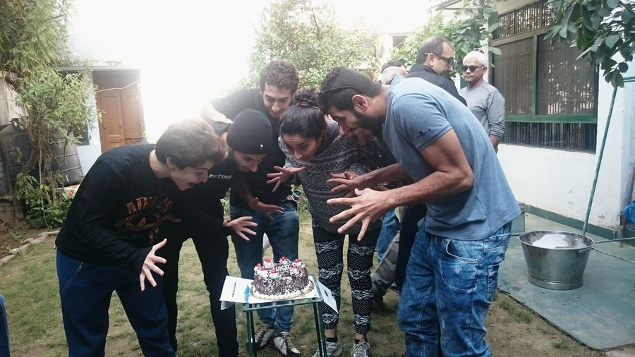 Adult Bonding Cake Cheerful Day Enjoyment Friendship Happy Birthday! Holding India Joy Medium Group Of People Mid Adult Mid Adult Men Outdoors Palestine People Smiling Surprise Tasty Togetherness Women Young Adult Young Women