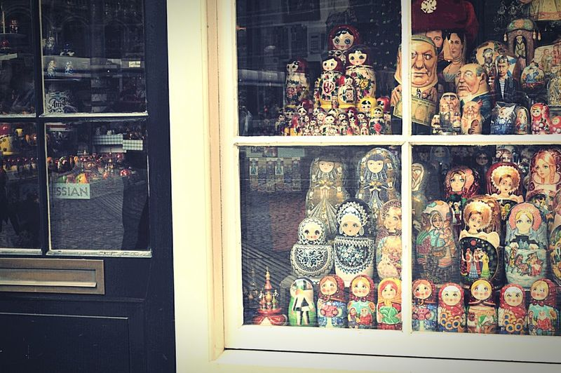 Shopping in Amsterdam Russian Dolls Gift Shop Shop Front Shop Window Shop Display Window Display Window Reflections Window Shopping Black Door Street Reflections Tram Street Photography Amsterdam Streets Amsterdam Life Walking Around Hanging Out Taking A Break Nikon D3200