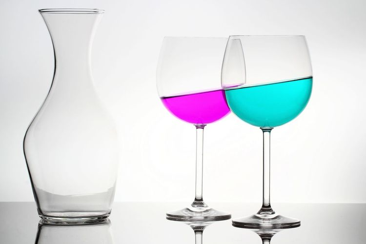 Close-up of wineglass against white background