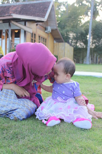 Woman With Baby Girl At Yard