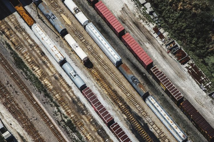 Aerial View Of Freight Trains On Tracks