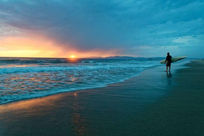 Surfer watching sunset. Surfing Sunset Ocean View Ocean Waves Nature Calm Hermosa Beach, California Beach