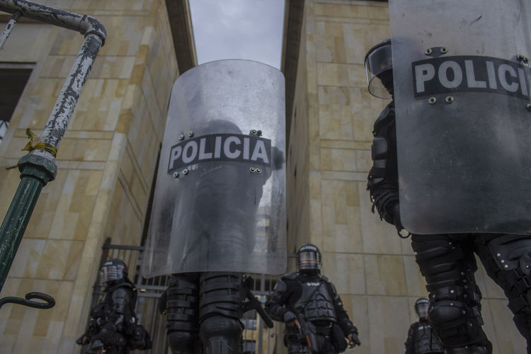 Low angle view of police force with shields on street