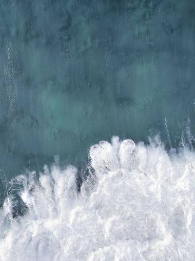 Aerial shot of a wave texture in the ocean