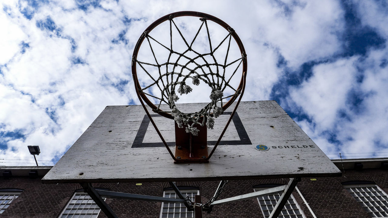 basketball hoop, basketball - sport, sky, cloud - sky, basketball, sport, low angle view, architecture, day, built structure, no people, building exterior, outdoors, close-up