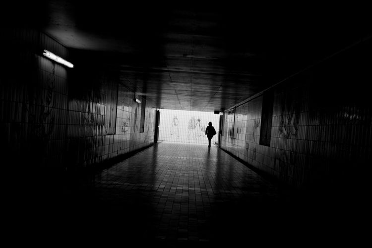 Silhouette Person At Underground Walkway