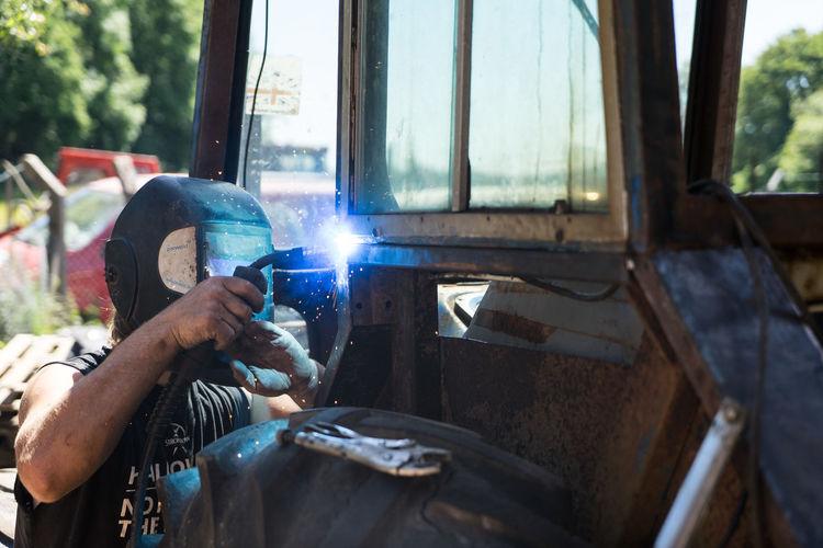 Young man welding in workshop