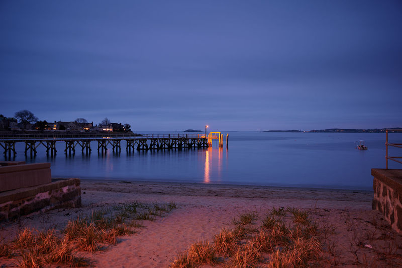Illuminated pier at dusk. View from the beach. Water Sky Architecture Sea Built Structure Nature Illuminated Scenics - Nature Beauty In Nature Beach Sunset Dusk Cloud - Sky No People Land Motion Tranquil Scene Tranquility Building Exterior Outdoors Horizon Over Water New England  Ocean