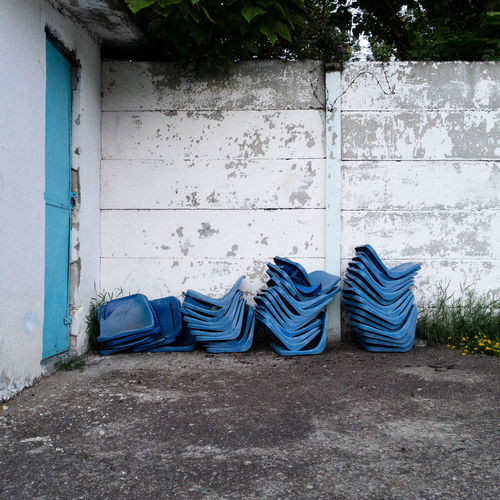Chair Abandoned Blue Building Exterior Built Structure Concrete Day Door Fence No People Old Outdoors Steel Tree Wall