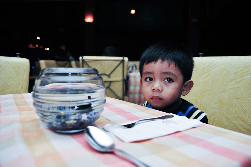 Child One Person Children Only Table People Sitting Childhood Indoors  Portrait One Boy Only Night Close-up Dinner