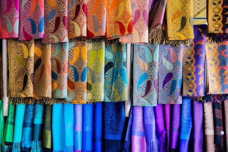 A selection of fabrics No People Colour Of Life Market Color Fabric Rainbow Market Stall Vibrant