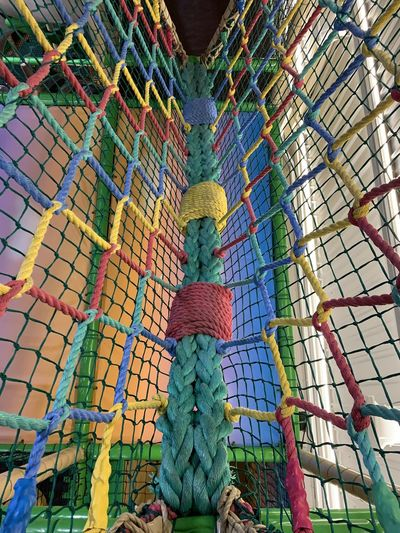 Low angle view of multi colored ropes